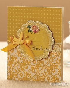 handmade card ... monochromatic yellow ... balanced design ... lovely patterned papers ...