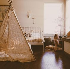 Looking for ideas for adding a boho vibe to your kids room? These tips will totally help you  design a whimsical child's bedroom