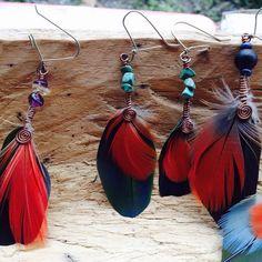 We found these #guacamaya #macaw #feathers outside of the #copal #honduras #ruins and fashioned with #costarican #perico to create these #earrings #turquoise #fluorite #citrine #lapislazuli #jojobaseed.  #chakra #chakrastones #sacredgeometry #boho #bohochic #artesania #wirejewelry #handmadejewelry #handmade #hechoamano #feitoamao #wirewrapped #artesano #nativeamerican #centralamerica #hippiestyle Wire Jewelry, Handmade Jewelry, Chakra Stones, Flower Of Life, Honduras, Sacred Geometry, Hippie Style, Lapis Lazuli, Feathers