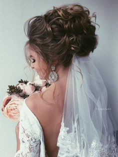 Ulyana Aster Long Wedding Hairstyles & Wedding Updos / http://www.deerpearlflowers.com/romantic-bridal-wedding-hairstyles/4/