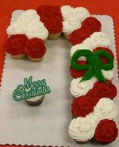 Candy cane cupcake cake! So cute and personalize it with the flavors of your choice! Sweetestcreationfavors@gmail.com