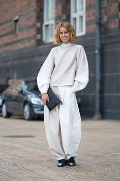 The best street style photos from Copenhagen Fashion Week where insanely huge and out of proportion sweats are ALL THE RAGE PEOPLE