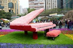 a piano in flowers.  I wonder if it is quiet music?