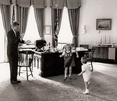 Fun in the Oval Office as the President encourages young Caroline and little John Jr. to dance.
