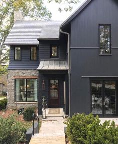 Dark exterior color & black trim mixed with brick and metal for added texture