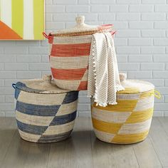 If you want to keep items in baskets be sure you invest in sturdy ones that are add to the decor. I love these myself! Graphic Printed Oversized Basket | west elm