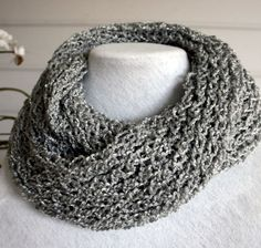 A hand knitted infinity scarf made with a by TrinksKnitting
