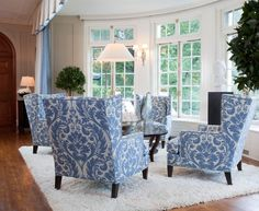4 wing backs around a coffee table in blue and white
