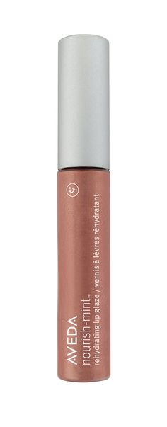 Go nude with Nourish-Mint Rehydrating Lip Glaze in Desert Earth. An added hint of shimmer makes lips look fuller.