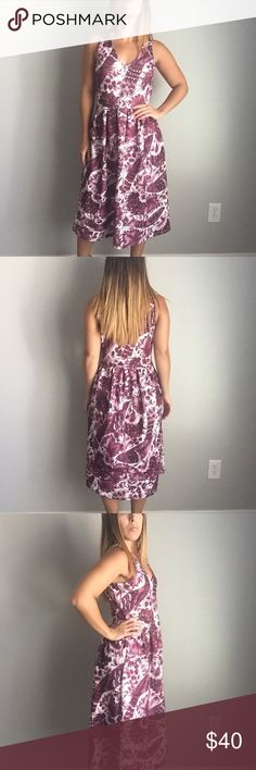 """ASOS Purple Floral Midi Dress Hello 50's house wife! This dress is so classic and beautiful. V-neck. 95% cotton and 5% elastane. I am a size 2 as pictured and I am 5'1"""" for length reference. ASOS Dresses Midi"""
