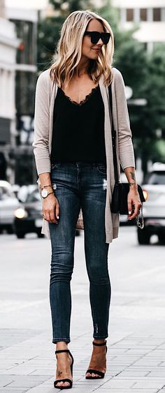 Taupe cardigan over lace top with blue jeans.