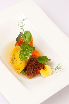 Sea trout with garden pea, nasturtium and langoustine dashi by Phil Fanning