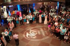 Wedding lighting. Monogram for the dance floor and icy blue uplights around the room. Mile High Station, Denver, CO.