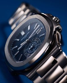 "Patek Philippe Nautilus 40th Anniversary 5976/1G Watch Is 49.25mm Wide In 18k White Gold - by David Bredan - Just announced, see all about it on aBlogtoWatch.com ""In 2016, the Patek Philippe Nautilus watch collection turns 40 years old, and a lot of the brand's fans have been wondering what the important luxury Swiss watchmaker would come up with. Today, we know the answer to that, and it is very large, gold, fitted with diamonds, and surprisingly not costing more than $100,000..."""