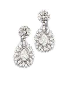 Pair of Diamond Pendent Earrings. Each set with a pear-shaped diamond weighing approximately 6.00 carats in total, suspending within a marquise-shaped and circular-cut diamond frame, to the circular-cut and baguette diamond top, the diamonds weighing approximately 6.00 carats in total, mounted in 14 karat white gold, post and hinged back fittings.