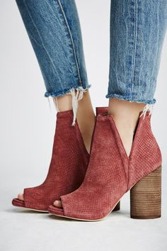 Infinity Heel Boot | Modern suede ankle boot with a peep toe design and structured side cutouts. Chunky block heel for a cute and comfortable step. Padded footbed for support.
