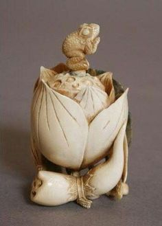 Frog on lotus flower with lotus root at the side netsuke