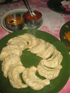 Momo, steam dumpling .. Is the no.1 fast food of Nepal, which Iis served with home made tomato chutney ( sauce) yummm..