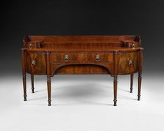 Large Regency Mahogany bow ended sideboard raised on reeded legs, 7' wide and impressive quality. Terrific provenance available