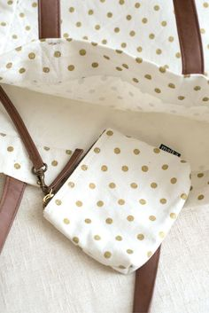 """Metallic Gold Dots Carryall 18"""" x 14"""" x 6"""" Printed on recycled canvas with eco-friendly pigment inks. Our roomiest utility tote yet: featuring interior pockets, strap and hook to attach our pouches. T"""