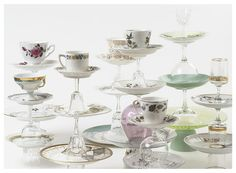 Inspiration for using cake stands and tea cups for window displays
