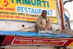 Stock Photo : Painter on a shop roof