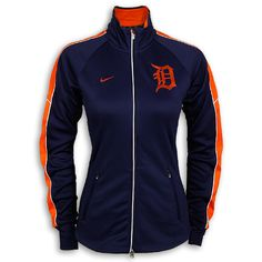 """Detroit Tigers LADIES Dri-FIT Tempo Track Jacket by Nike - XL ONLY  Detroit Tigers LADIES Dri-FIT Tempo Track Jacket by Nike. This ladies jacket is made with Nike's Dri-FIT technology. It features an orange """"D"""" heat transfer left chest and the Nike """"Swoosh"""" right chest. The pockets also have zippers. 100% Polyester."""