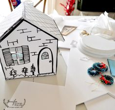 Cute hand drawn houses put together with foam core
