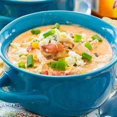 Crock Pot Buffalo Chicken Chili is a creamy and rich white bean chili with shredded chicken, corn, fire-roasted tomatoes, buffalo sauce, and blue cheese. It's the soup version of Buffalo Chicken Dip and a bowl Buffalo Chicken Chili, Shredded Buffalo Chicken, White Bean Chicken Chili, Buffalo Chicken Recipes, No Bean Chili, Chili Recipes, Crockpot Recipes, Drink Recipes, Dinner Recipes