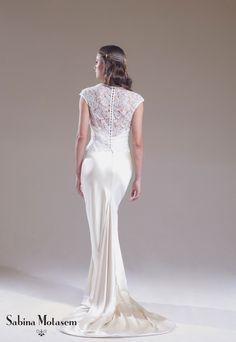 The Elsa dress worn with the Evelyn bodice – Sabina Motasem. A slip-style bias cut, backless, slinky satin wedding dress with spaghetti straps worn with a lace bodice.  www.motasem.co.uk #biascutweddingdress