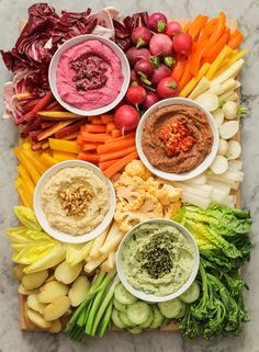 Roasted beet hummus with dill and lemon zest; spicy black bean hummus with roasted red peppers and sesame seeds; white bean hummus with toasted pine nuts and curry powder; and edamame-avocado hummus with furikake❤️ Party Food Platters, Veggie Platters, Veggie Tray, Raw Food Recipes, Appetizer Recipes, Cooking Recipes, Healthy Recipes, Detox Recipes, Cooking Tips