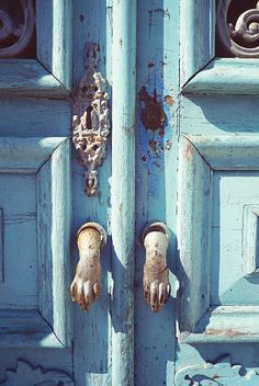 Adore this door!    blue and rust - love the hands and the old lock next to the new:Patricia Hayes via Rita DiGenova onto Doors and More