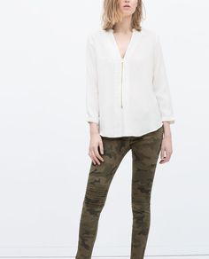 Image 2 of CAMOUFLAGE TROUSERS WITH ZIPS from Zara