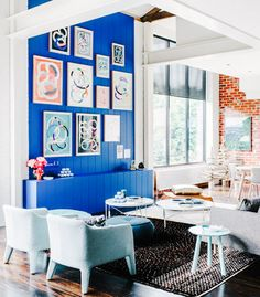 Blue feature wall in living room with gallery wall