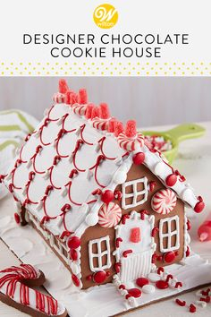 Designer Chocolate Cookie House One look and you won't be able to wait to decorate this chocolate cookie house, bright with visions of peppermint colors and candy. Sharing the activity of decorating this house together makes the entire family merry! Homemade Gingerbread House, Cool Gingerbread Houses, Gingerbread House Designs, Gingerbread House Parties, Gingerbread Village, Christmas Gingerbread House, Christmas Desserts, Christmas Baking, Christmas Cookies