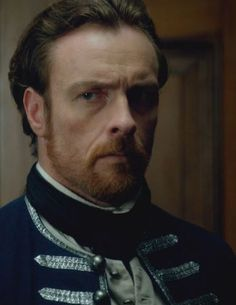 Toby Stephens as Captain James McGraw, British Navy. Before unbridled anger, desire for vengeance, and need for a new job turned him into Captain Flint, Pirate. Captain Flint, Shark Stuffed Animal, Black Sails Starz, Beautiful Men, Beautiful People, Charles Vane, Key West Beaches, Toby Stephens, Pirate Queen
