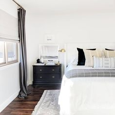 Loving how clean and bright this bedroom feels. Layer drapes over a roman shade for an extra cozy feel. It's like a blanket for your windows and really helps soften up the room. Striped Room, Room Upgrade, Bedroom Decor, Baby Room Decor, Home, Master Bedroom Design, Neutral Decor, Neutral Design, Room