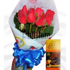 Half dozen bouquet of elegant long stemmed red roses and a bar of Cadbury Dark chocolate with roast almond(200g) send this mouthwatering chocolate bar and fresh bouquet of roses to your very best friend on Eid Day.  Shipped in a box and comes with a FREE personalized beautiful message card.