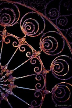 evening gate ~ I have a rusty gate that I bought at Salvage One in Chicago years ago that I'm using over the mantle. Not as ornate as this one,but a similar style and color.