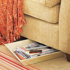 Book &magazine overflow? Keep reading material neatly stacked in a tray. You'll have everything at the ready with a slim basket that can easily slip underneath the furniture. Via All You