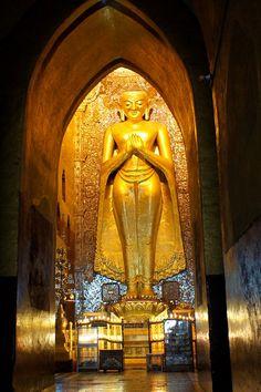 *Towering Buddha statue inside a pagoda
