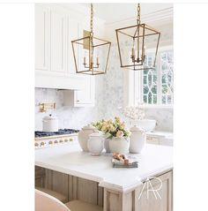 White cabinets and wood tone island