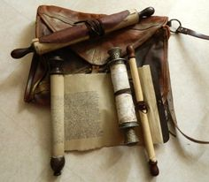scrolls from library of Alexandria. film agora (making my own with rolling pins & tea stained contact paper wrapped with leather strips.)