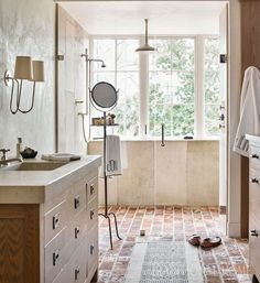 Brick flooring, wooden cabinetry, and a nubby runner lend a rustic texture to this man's bathroom. Brick Bathroom, Master Bathroom Layout, Man Bathroom, Bathroom Flooring, Bathroom Ideas, Master Bedroom, Parisian Bathroom, Bathroom Canvas, Neutral Bathroom