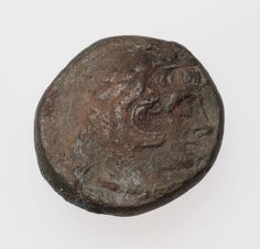 Coin of Kingdom of Egypt with head of Herakles, struck under Ptolemy III. Greek, Hellenistic Period, 247-222 B.C.