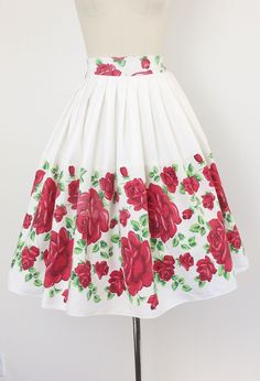 ** RESERVED RESERVED RESERVED ** ** Half now - half later - $185 total ** Awesome red rose border print full skirt from the 50s. Sweet white background with vivid red roses throughout the border. Metal zip with waistline button closure. Medium weight cotton. Just beautiful! Made from 50s fabric and was part of my personal collection for quite a while.  | c o n d i t i o n | good - some slight fading on some of the roses.  | m e a s u r e m e n t s | fits a modern day size 8 waist - 28…