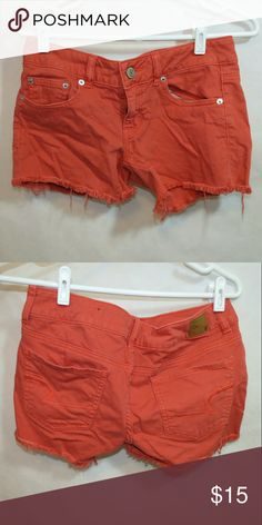 American Eagle orangey-red denim shorts American Eagle orangey-red color denim shorts. Stretch. Size 6. Like new condition. Smoke-free home. Have different colors in separate listings.   ** save on bundles ** American Eagle Outfitters Shorts Jean Shorts