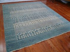 VIN229A Rug from Vinyard collection.  This country styled Vinyard Area Rug by Safavieh, VIN229A, revives rural village motifs in vibrant shades of blue and luxurious textures.