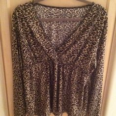 Plus size 2x lane bryant animal print sweater top 3/4 sleeves animal print cheetah leopard  print deep V neck new condition  lane Bryant top soft i like how its flowy like synchs and comes in at the waist flattering for your curves size 2x its stretchy ! Great with legging or jeans ! Bundle now save 20% off any two + items Lane Bryant Sweaters V-Necks