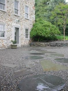 Bibi Monnahan / stone set in pea gravel [via remodelista]  ok, this is my fave, widely spaced stone
